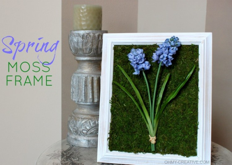 Transform a picture frame with moss mat, silk flowers and a few other craft supplies into this pretty Spring Moss Craft Frame Decor! | OHMY-CREATIVE.COM