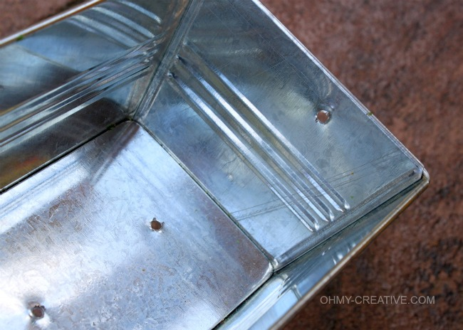 Tin with drilled holes