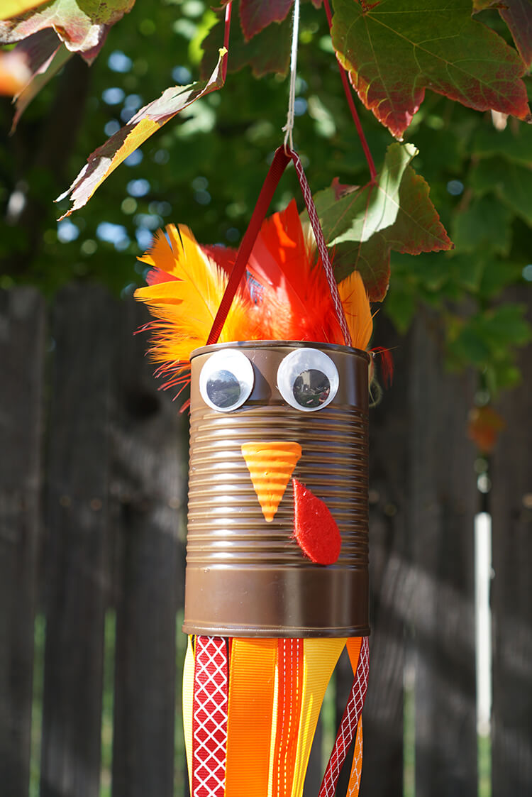 Turkey windsock made from a tin can, feathers and ribbons...too cute!
