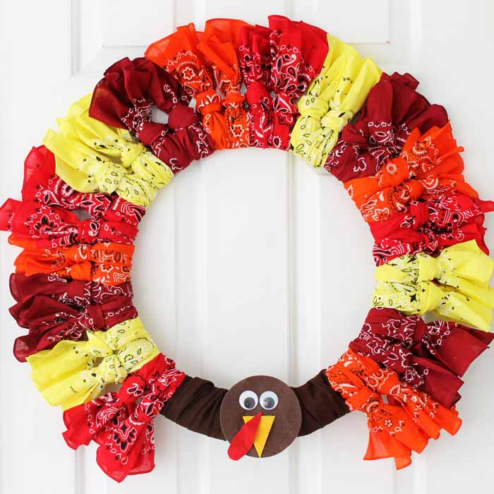 Adorable turkey Thanksgiving wreath made with colorful bandanas!