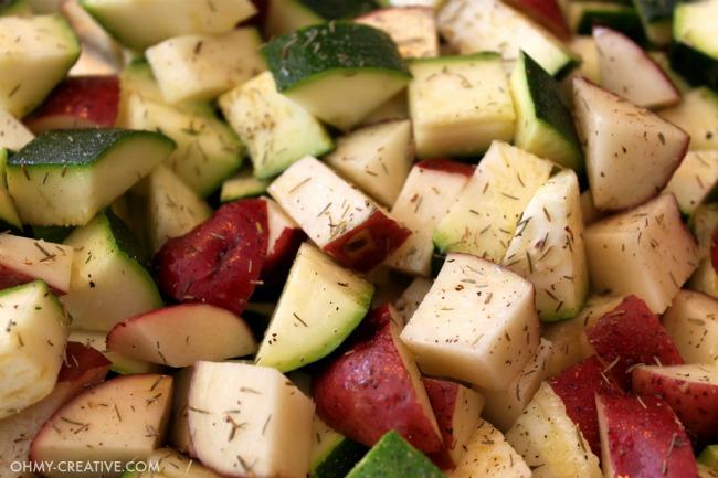 Chopped potatoes and zucchini with seasoning.