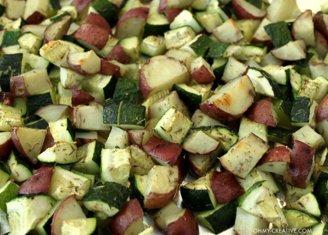 "This is one of my favorite ""go to"" recipes. Not only is this Roasted Potatoes And Zucchini Side Dish easy to make it is also delicious and compliments any main course! 