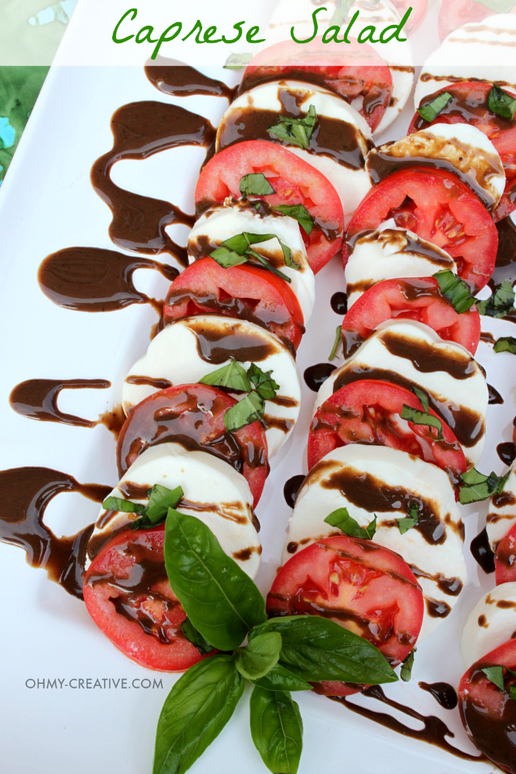 This Caprese Salad Recipe couldn't be easier and it is a great way to use up tomatoes and basil from the garden! So tasty! | OHMY-CREATIVE.COM