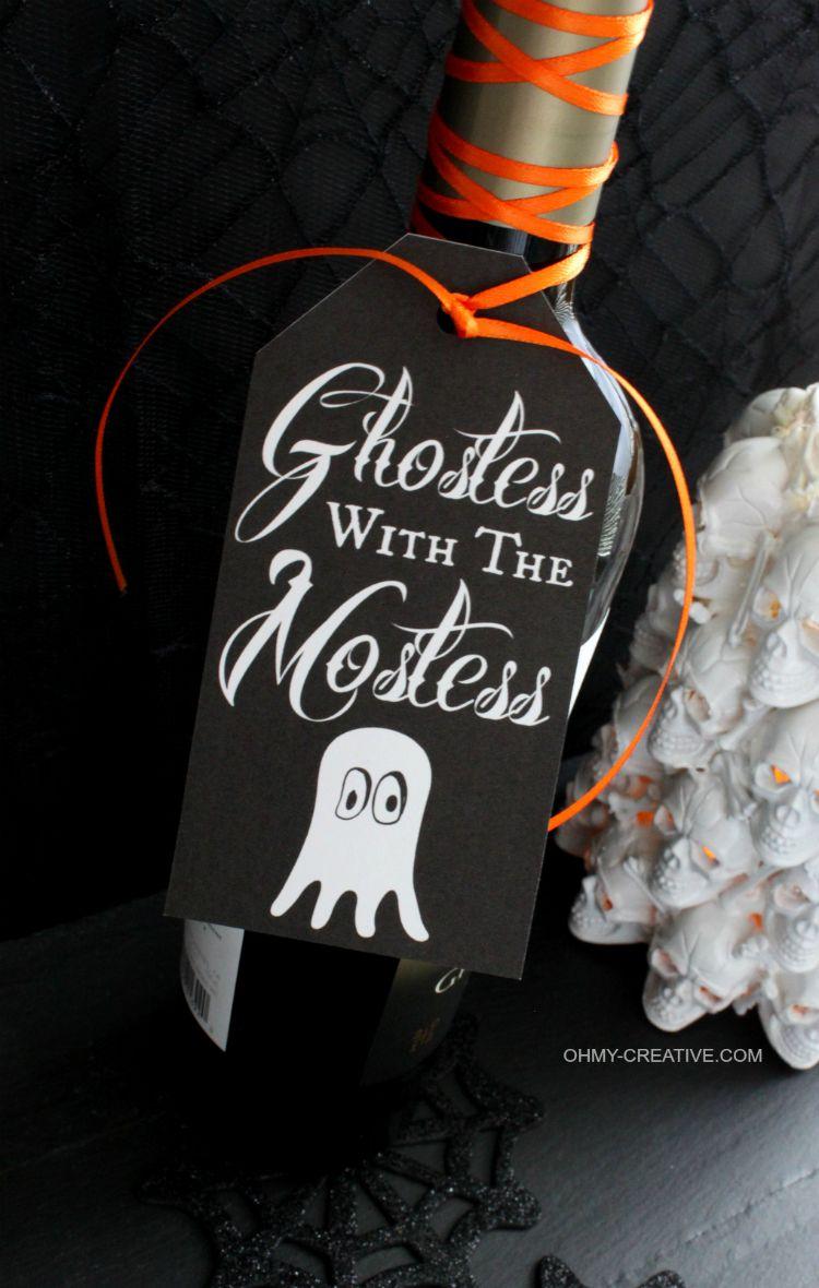 Use this Free Halloween Printable Gift Tag to attach to a bottle or gift bag for a Halloween party hostess gift…Ghostess with the Mostess   OHMY-CREATIVE.COM