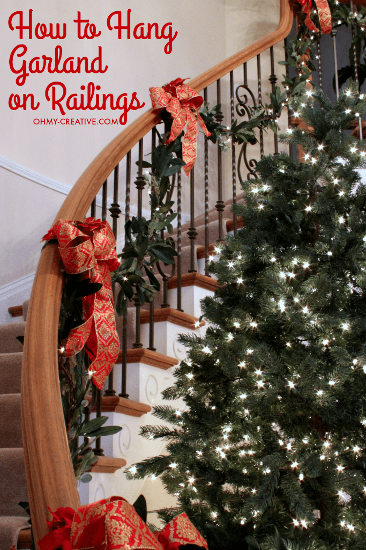 Cascading garland is a gorgeous way to decorate the staircase, but can seem to be a challenge to attach. With this quick tip, it can be so EASY to Hang Garland on Staircase Banisters | OHMY-CREATIVE.COM