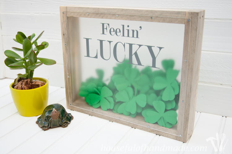 Make a beautiful shadow box full of clovers for a fun St. Patrick's Day shadow box decor idea. See if you can find the 1 4 leaf clover in the bunch.   OhMy-Creative.com
