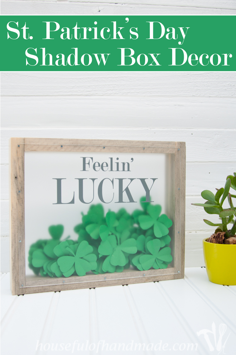 Make a beautiful shadow box full of clovers for a fun St. Patrick's Day shadow box decor idea. See if you can find the 1 4 leaf clover in the bunch. | OhMy-Creative.com