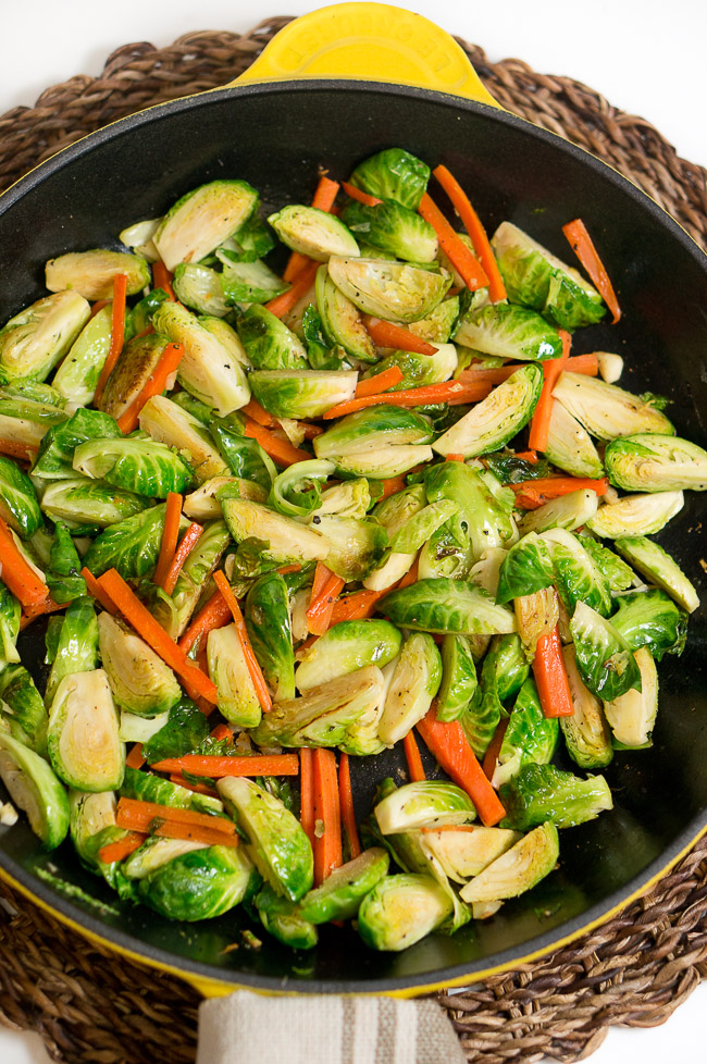 Sauteed Brussels Sprouts and Carrots Side Dish - 25 Thanksgiving Side Dishes to complete your Thanksgiving dinner! Including Thanksgiving vegetable side dish recipes, traditional Thanksgiving recipes as well as new recipes to try! | OHMY-CREATIVE.COM