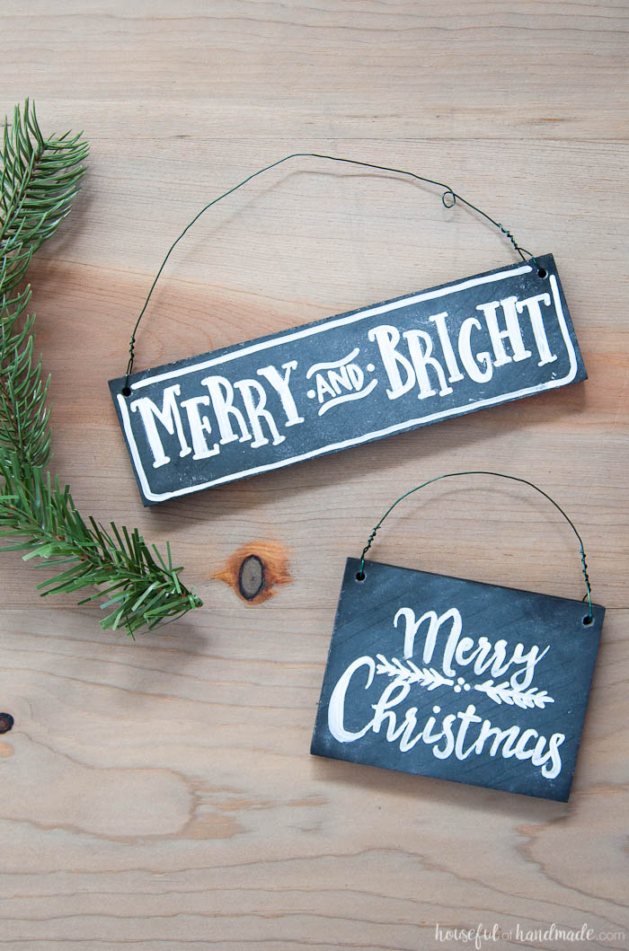 These Christmas ornaments are perfect for my rustic decor! Learn how to make these DIY chalkboard sign ornaments with just a few simple steps. They are perfect for a farmhouse style Christmas or to gift to friends and family. | Housefulofhandmade.com