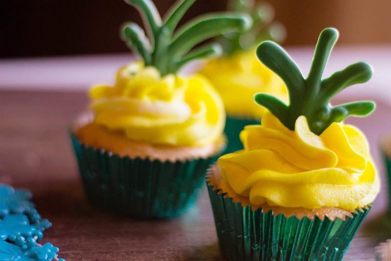 These Pina Colada Cupcakes are a tasty summer treat! Rum optional   OHMY-CREATIVE.COM   Pina Colada Cupcakes   Tropical Cupcakes   Pineapple Cupcakes   Pina Colada Cupcakes with Rum   Hawaiian Cupcake Recipes   #PinaColadaCupcakesrecipe #cupcakes #luau # pinacolada #dessert