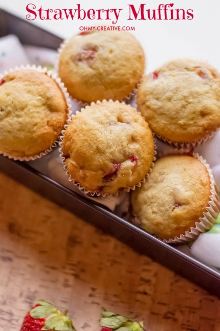 These Strawberry Muffins are made with Fresh Strawberries - an easy out the door breakfast muffin or snack! OHMY-CREATIVE.COM   Strawberry Muffins   Strawberry Muffin Recipe   Breakfast food   Snack Recipe   Muffin Recipe   Strawberry Banana Muffins #strawberrymuffins #muffinrecipe #breakfast #breakfastrecipe #muffins
