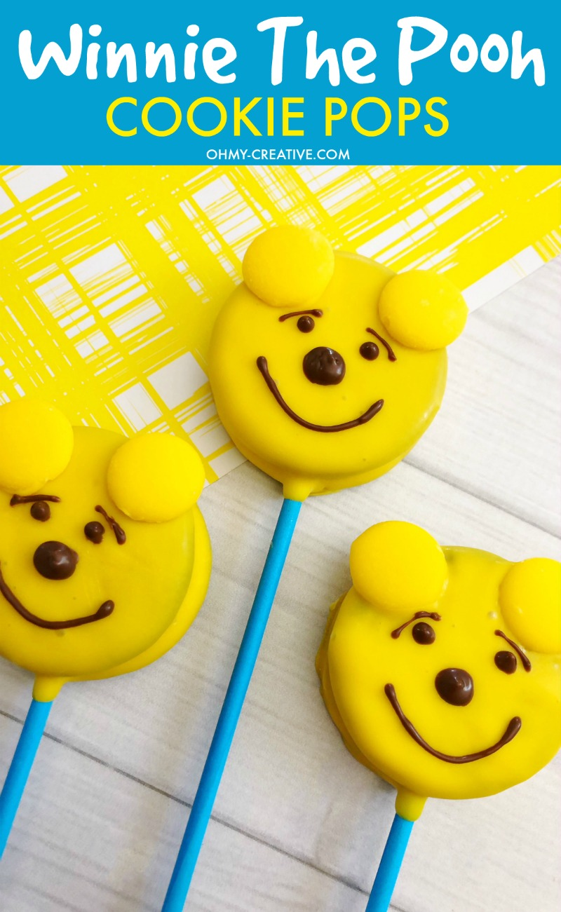These Disney Winnie the Pooh Cookies Oreo Pops are an adorable Pooh Bear treat! OHMY-CREATIVE.COM | Winnie the Pooh | Winnie the Pooh Pops | Oreo Pops | Winnie the Pooh Cookies #winniethepooh #winniethepoohmovie #winniethepoohcookies #oreopops #disney