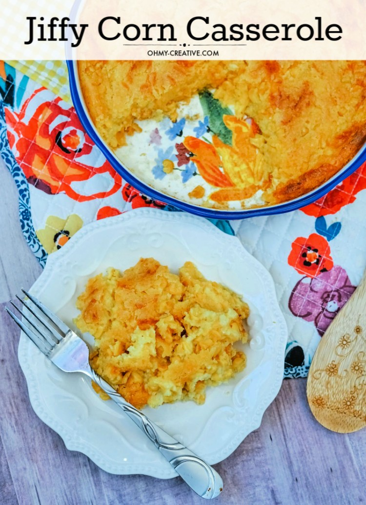 Round corn casserole with Jiffy baked with a single serving dished on a plate. Perfect for weeknight meals or a holiday side dish.