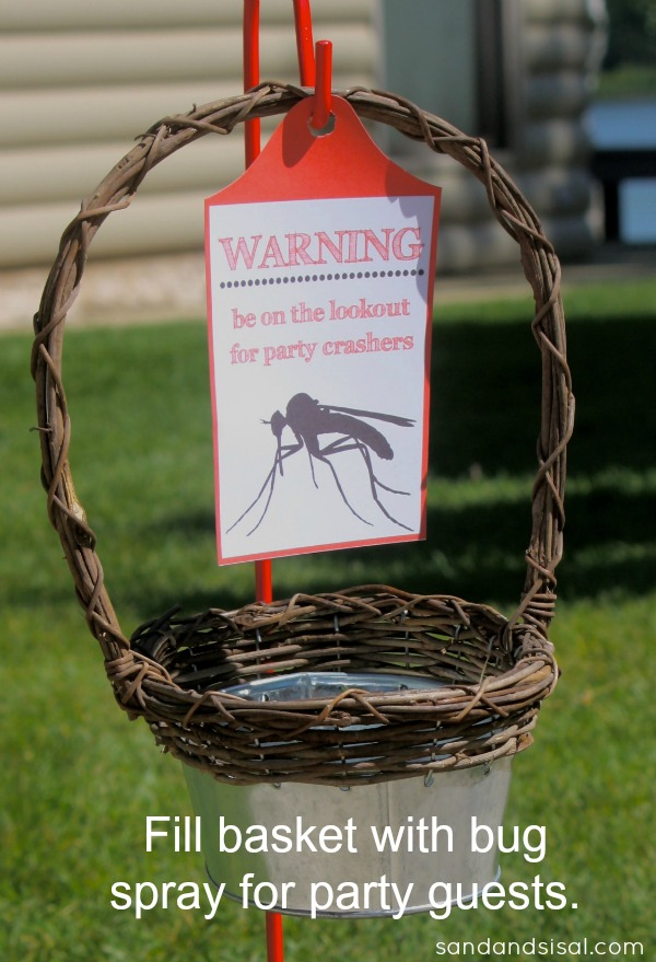 This outdoor party bug spray basket attache to a garden hook is a must for summer evening entertaining.