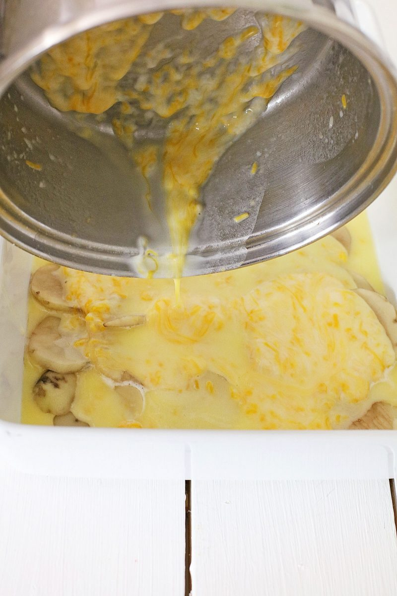 Pour the pan of melted cheese and cream over the sliced potatoes in the casserole dish.