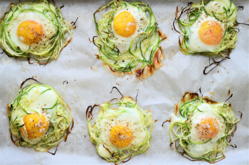 Pan of cooked zoodle egg nest fresh out of the oven.