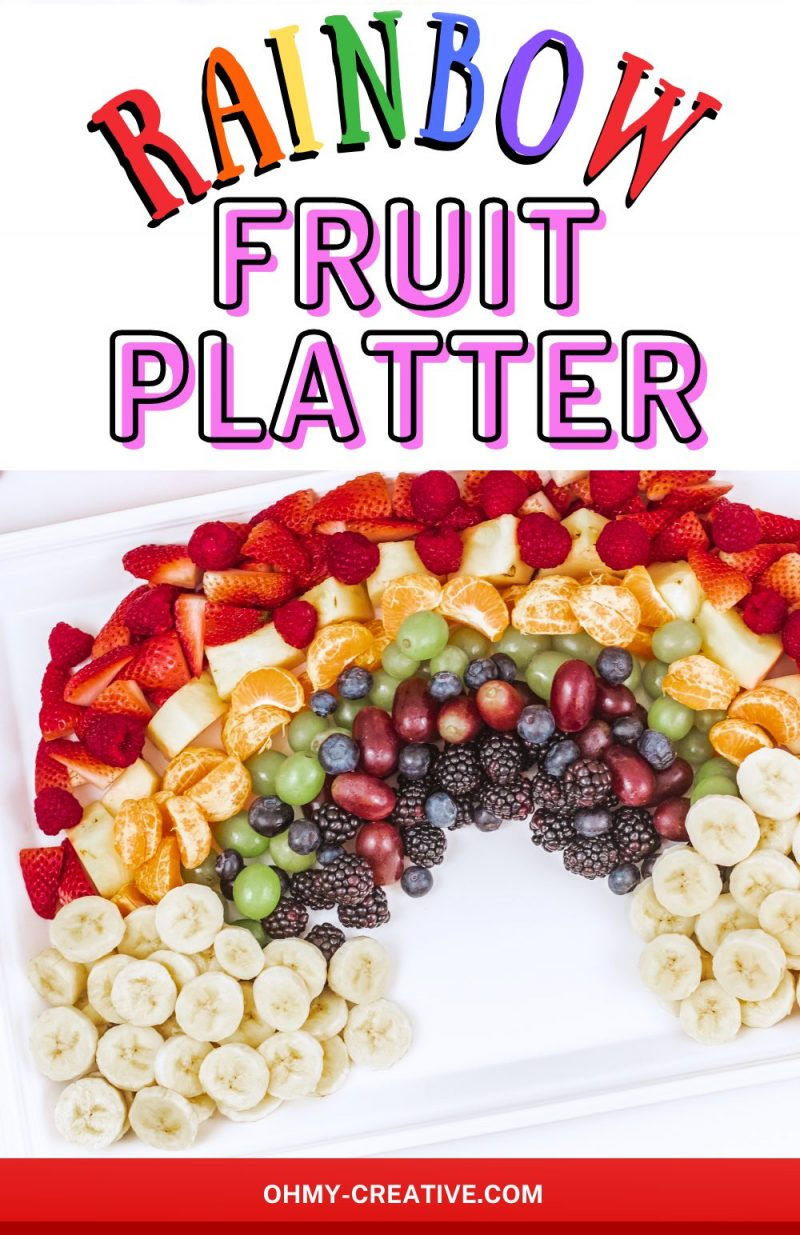 Finished Rainbow fruit platter with bananas as the clouds. A bowl of marshmallows is also pictured as and option for clouds.