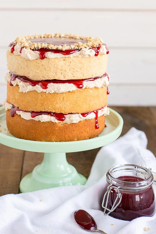 3 tier layer white cake with red jelly in between the layers.