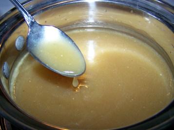chicken gravy in a metal bowl