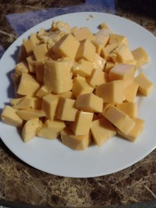 cubed cheese on a white plate