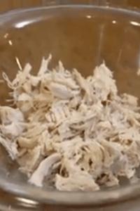 shredded chicken in a glass bowl