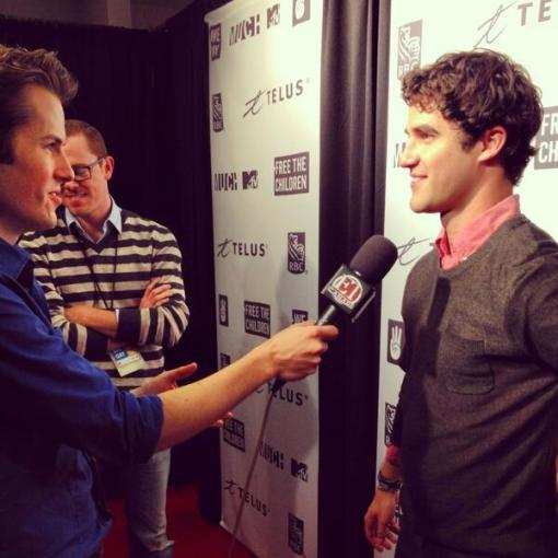 Darren-Criss-for-We-Day-in-front-of-our-Massive-Media-Wall-Logo-Banner