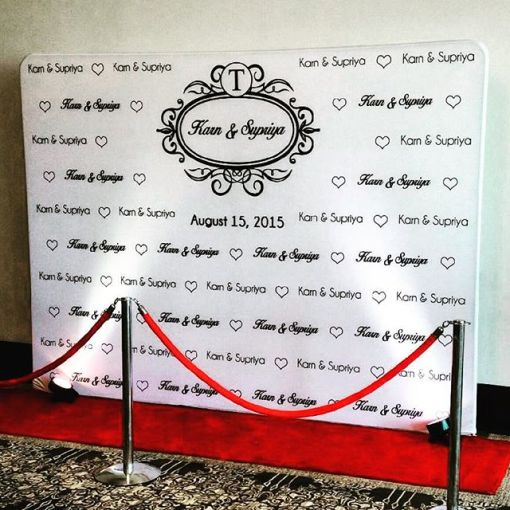 Wedding logo wall with red carpet