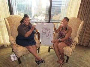 Nikka Shae and Karin Lang show an Adore Life t-shirt