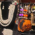 Pearl necklaces and feather earrings