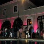 Guests mix and mingle poolside at the Pink Palace