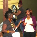 Celebrity stylist April B apply two strand twist to lucky guest while Jeannell hosts trivia giveaway with gueast