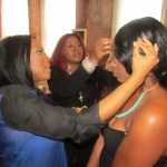 Janelle Langford and hair stylist Nina Akpan prepare the models for the camera
