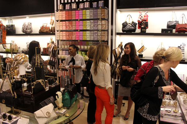 Guests mix and mingle over haute handbags, accessories, and other girly goodies