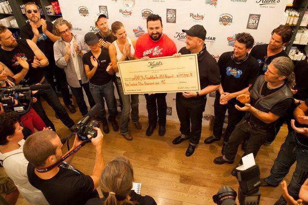 Kiehl's donates a hefty check to amfAR
