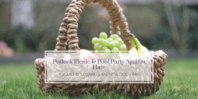 A picnic basket full of fresh fruit rests on the grass. Potluck Picnic & Pool Party Against Hate, August 12, 11am at Brentwood Park.