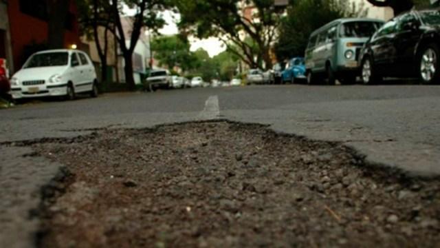 02 diciembre 2019, gobierno paga daños auto ocasionados por bache, bache, Ciudad de México, accidentes, baches, autos, propiedad privada