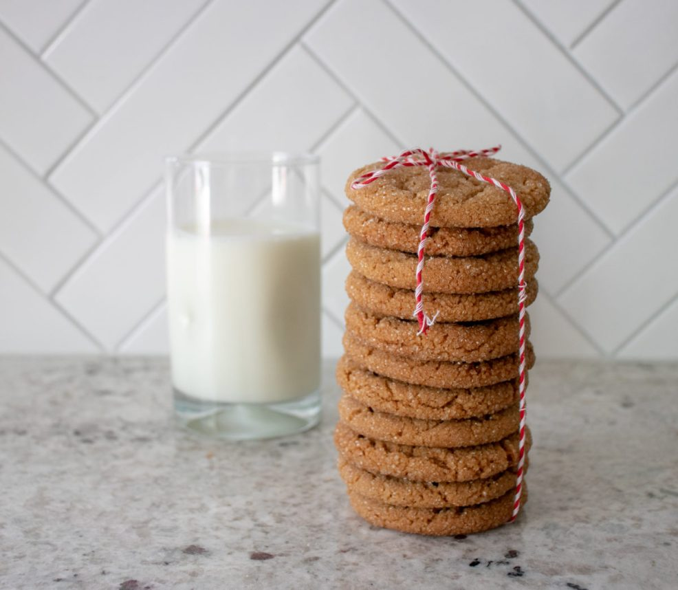 a fresh stack of molasses cookies and a glass of milk