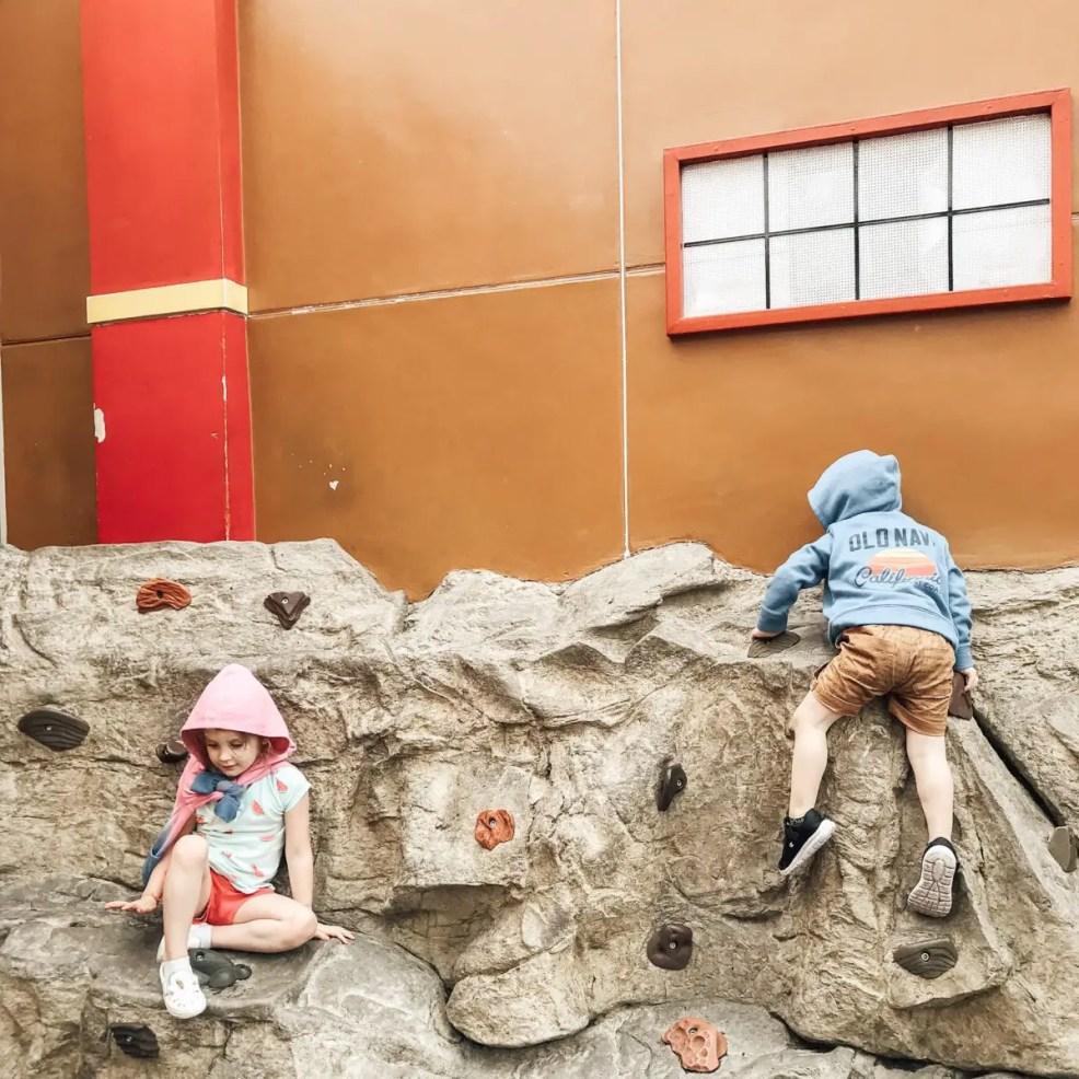 Children climbing on rock wall at Legoland California