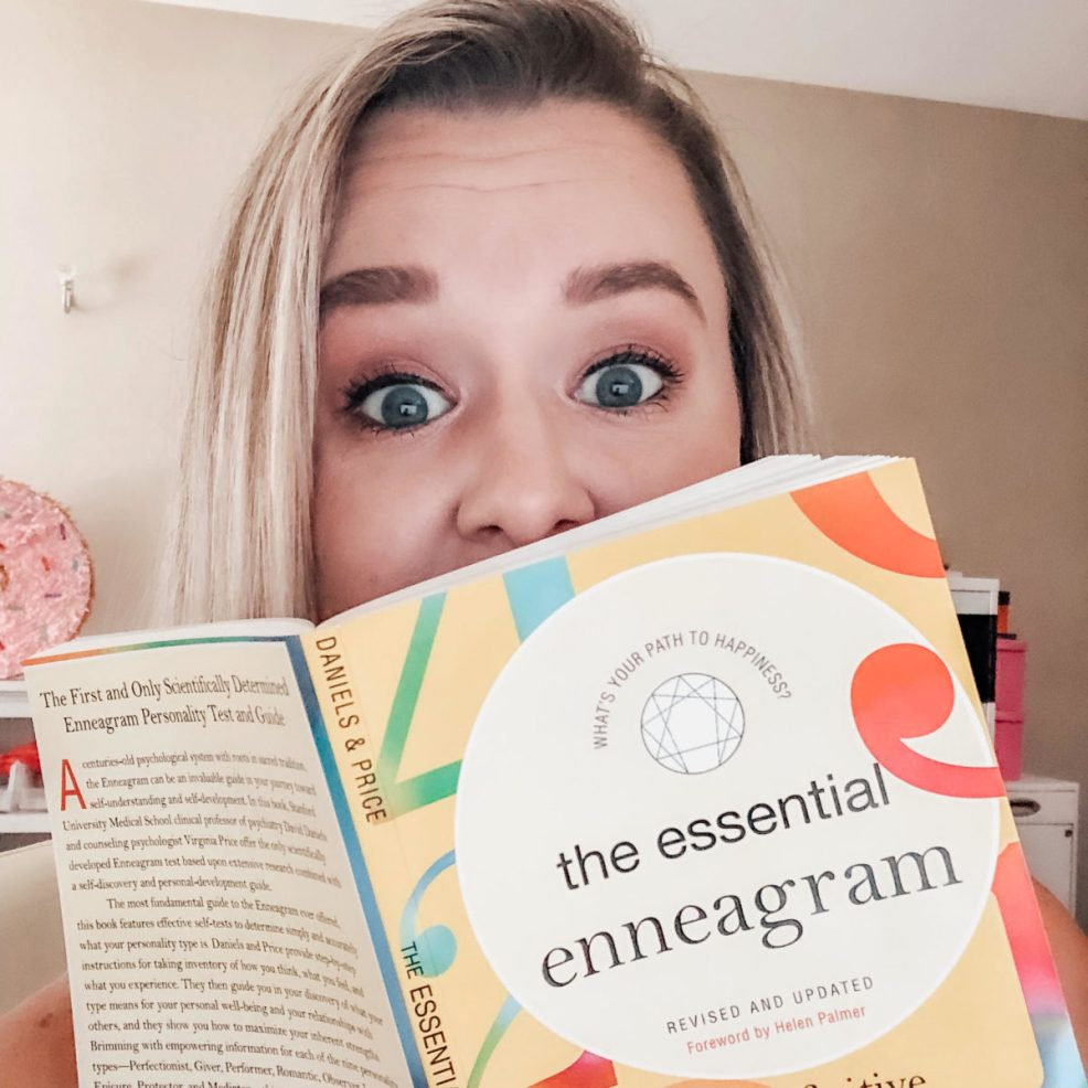 Brittany holding her favorite enneagram book.