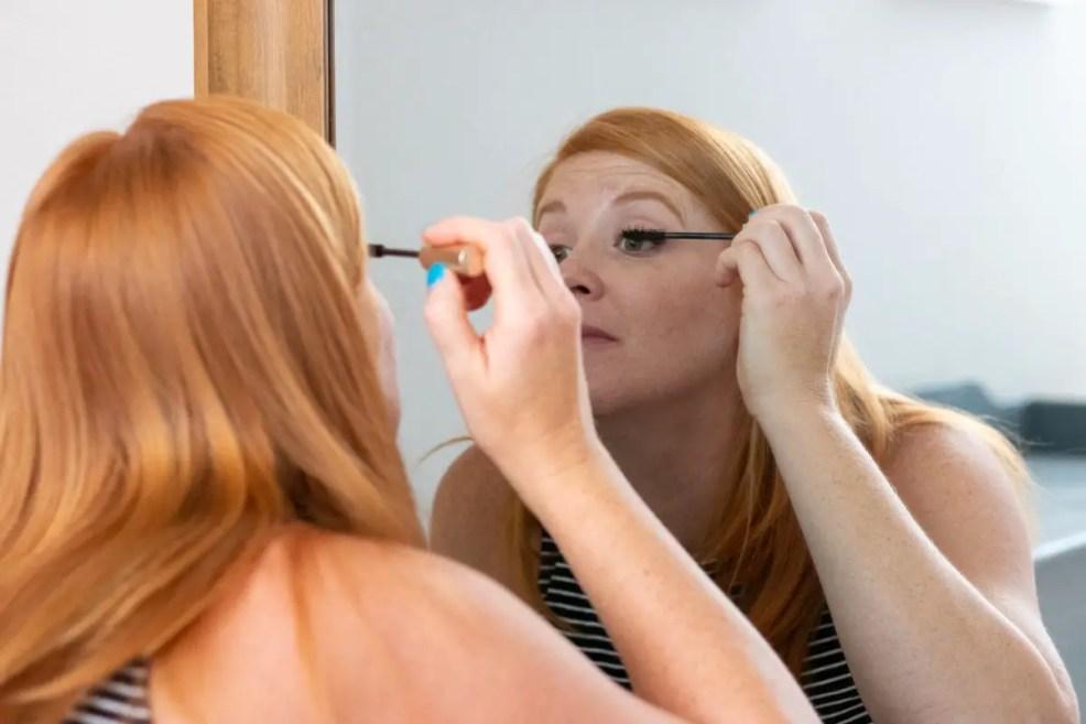 Heather applying mascara