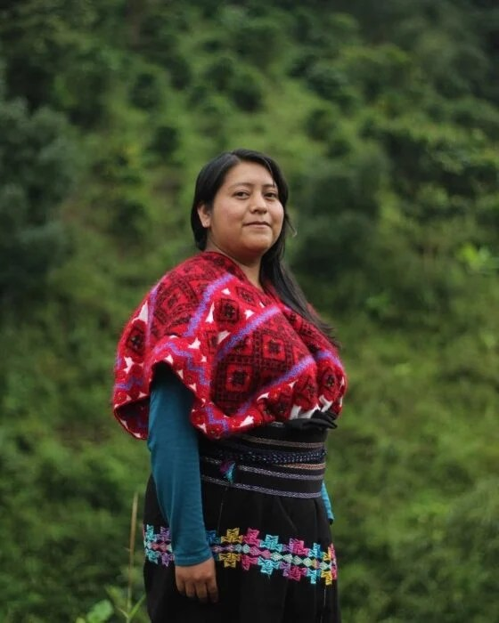 Indigenous woman from Mexico posing for a photograph