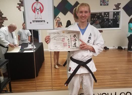 Steven with his IUKF Shodan Certificate and new Black Belt