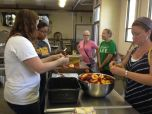 720x540 Chopping up the peaches, in Canning corn and peaches at Lowndes High School, by Gretchen Quarterman, for OkraParadiseFarms.com, 12 July 2014