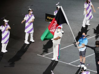Heartbreaking moment Afghanistan flag is flown at Paralympics with no athletes from the country behind it (photos)