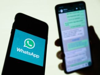 WhatsApp logo displayed on a phone screen and conversation on the WhatsApp displayed on a phone screen in the background are seen in this illustration photo taken in Krakow, Poland on August 27, 2021. (Photo Illustration by Jakub Porzycki/NurPhoto)