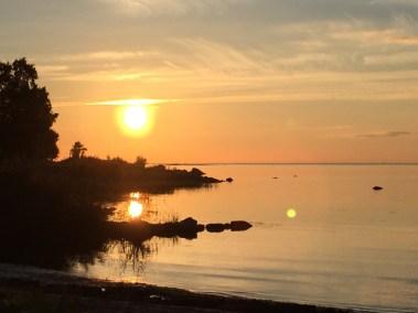 """Solnedgång vid """"vår"""" strand"""