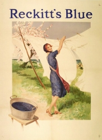 advertisement with woman hanging white washing on line near tub of blue water