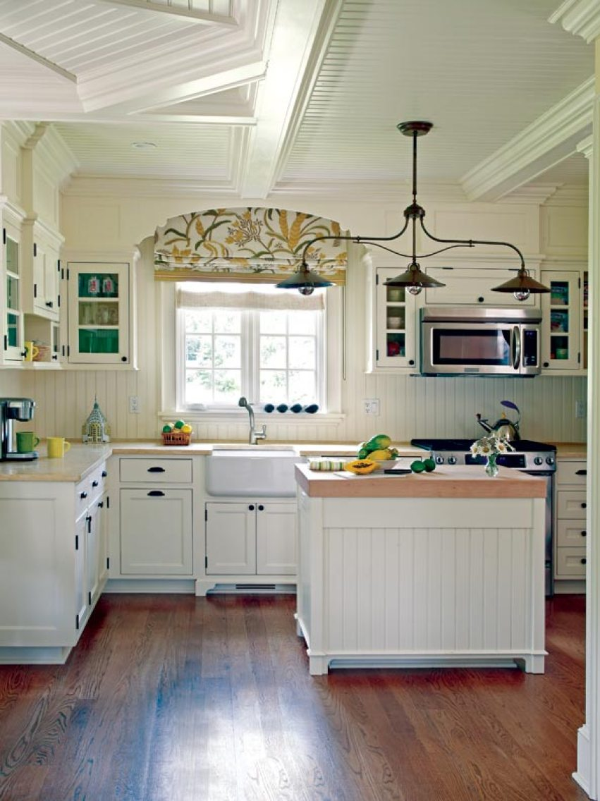 The kitchen is kept light and airy with traditional white cabinetry.