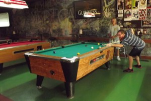 Plenty of pool tables in the game room.