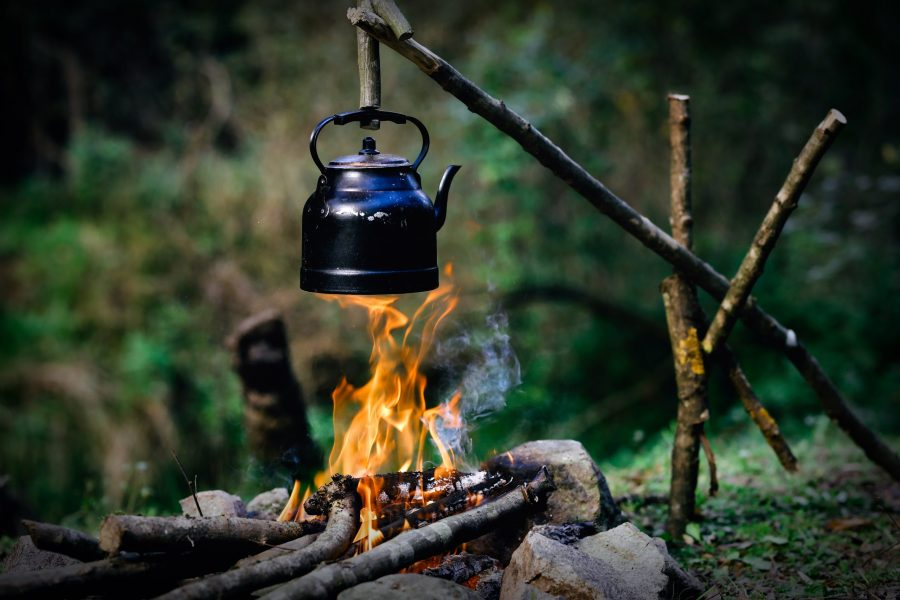 Teapot over campfire
